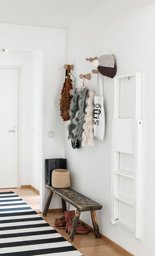 Bench, rug and hooks.