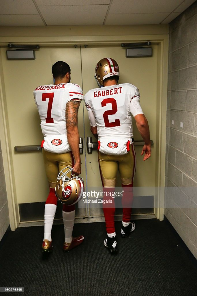 Colin Kaepernick and Blaine Gabbert of the San Francisco 49ers head to the field prior to the game against the Seattle Seahawks at CenturyLink Field on December 14, 2014 in Seattle, Washington. The Seahawks defeated the 49ers 17-7.
