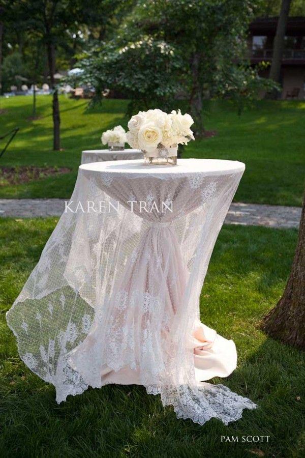 I really love this look on a high boy cocktail table. #lacelinens #weddingtables #cocktailtables #weddingdecor #weddingideas #weddings