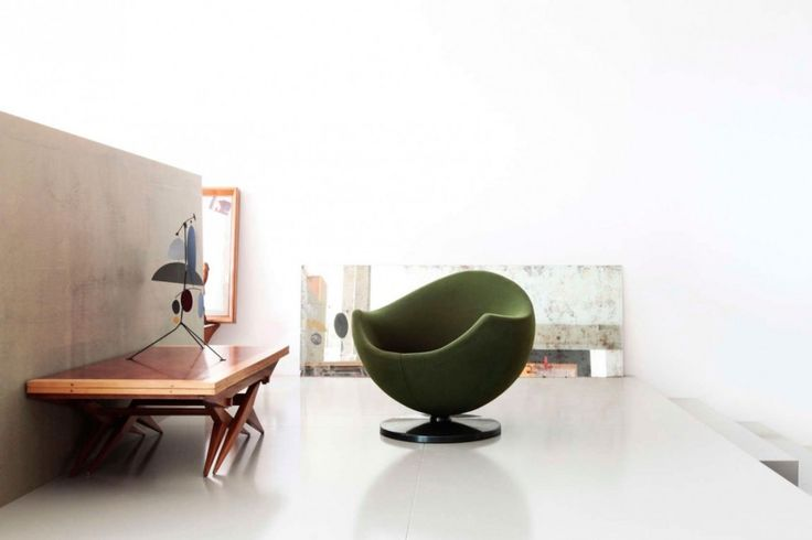 Loft: Spacious Pallars Loft Interior with Minimalist Style in Barcelona, Spain by KAYSERSTUDIO, Minimalist Pallars Loft Living Area Designed by KAYSERSTUDIO with Cozy Green Lounge Chair and Unique Wooden Table and Art Painting Decorations also White Themed Wall and Flooring