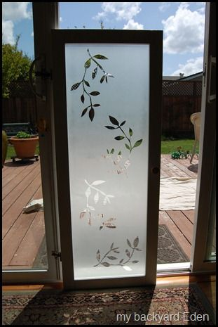DIY Frosted Glass Window: cut out paper design, affix to glass, then spray frosted  glass spray paint over