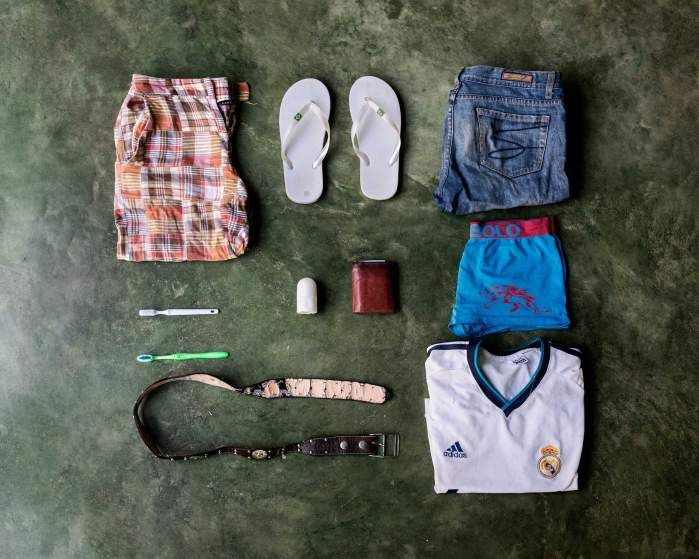 Photo Gallery: José Alfredo Bin, 27, from Guatemala. Deported from Mexico while he was trying to get to Miami, he wants to go to the U.S. to earn more money. In his bag, he has a pair of shorts, flip-flops, a pair of pants, two toothbrushes, deodorant, a wallet, underwear, a belt and a T-shirt of Real Madrid.