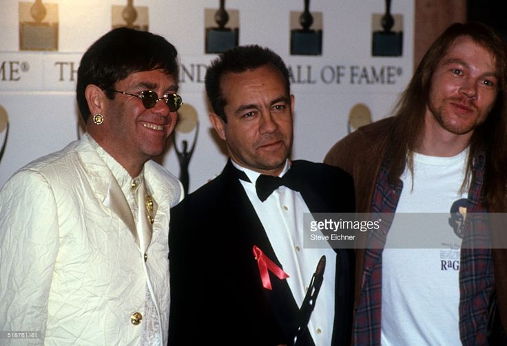 Elton John, Axl Rose of Guns N' Roses, and Bernie Taupin at Rock and Roll Hall of Fame Waldorf Astoria, New York, January 19, 1994.