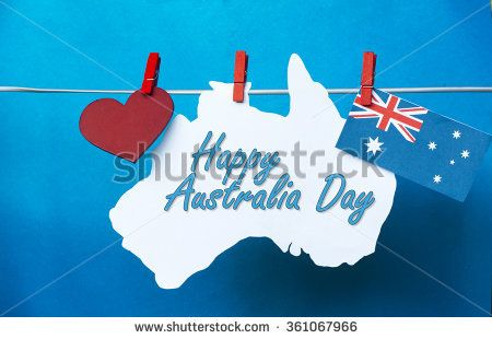 Celebrate Australia Day holiday on January 26 2016 with a Happy Australia Day message greeting written across white Australian maps (red heart) and flag hanging pegs on blue. Toned collage