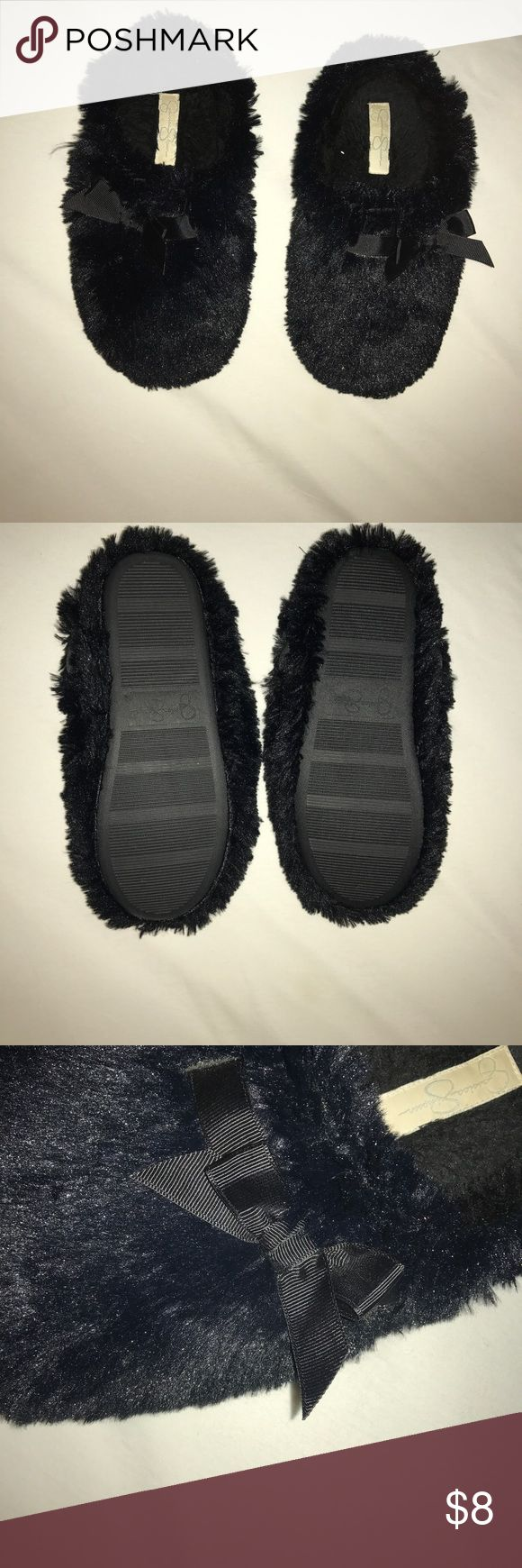 Black furry Jessica Simpson Slippers with bow Super cute and cozy!! Barley worn, selling because I do not wear anymore. Size 9-9.5 Jessica Simpson Shoes Slippers