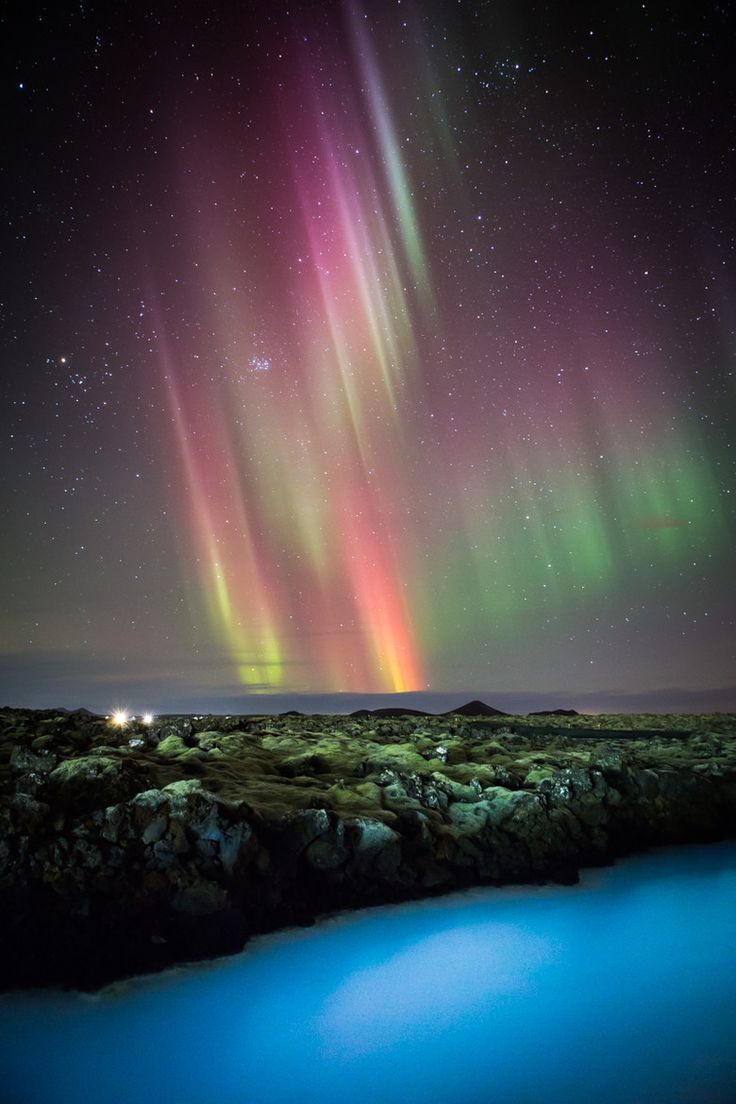 Northern Lights over the Blue Lagoon, Iceland. I don't have a bucket list, but if I did, this would be on it.
