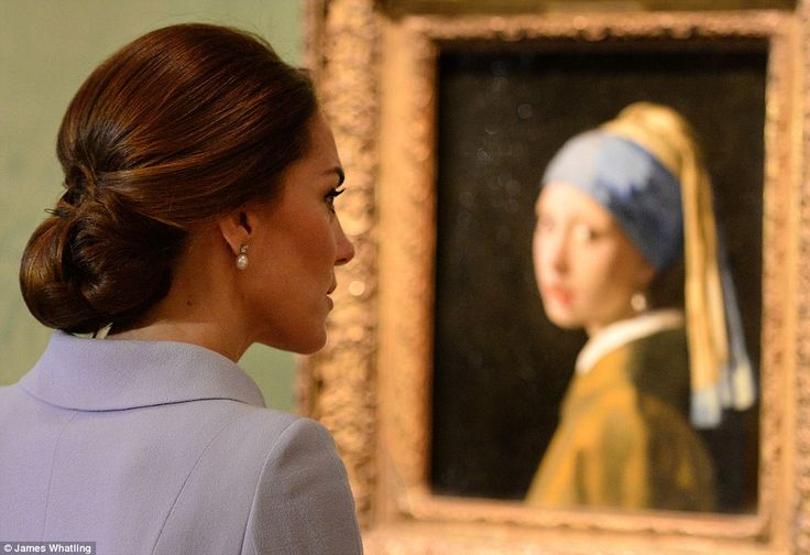 Kate views Vermeer's famous work The Girl With The Pearl Earring while wearing similar jew...