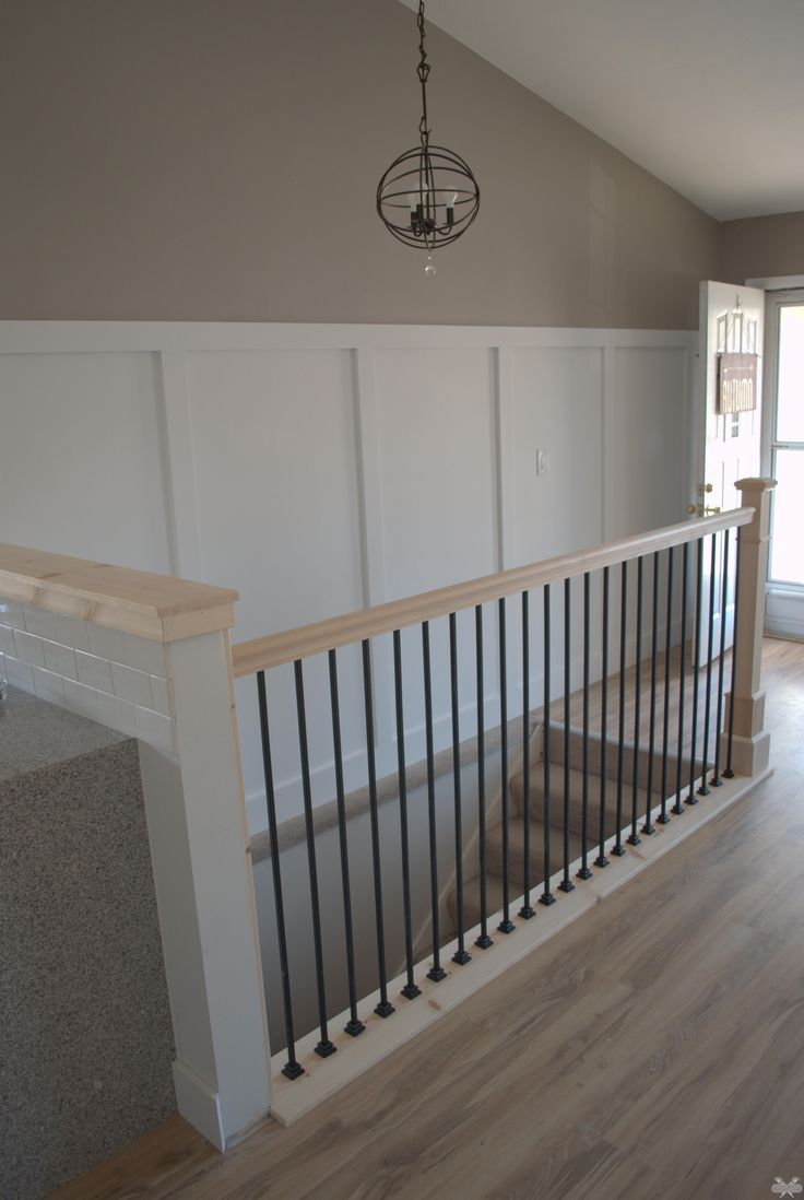 i like this banister style too (darker stain though) and I think the board and batten would look good on our wall there too....