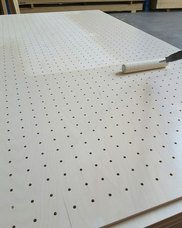 Perforated MAXI Birch plywood being prefinished with OSMO Oil