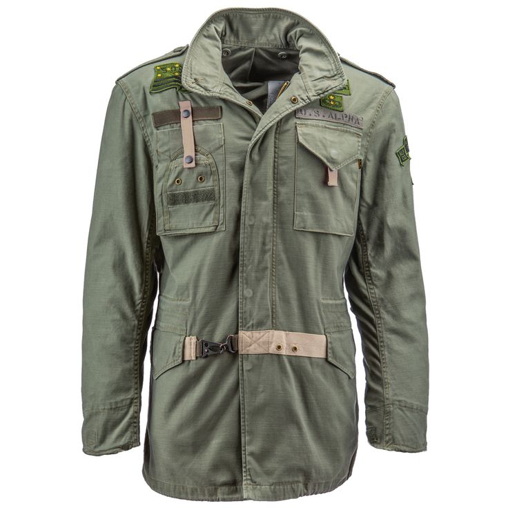 50th Anniversary M-65 Field Coat | Alpha Industries. A modern twist on the traditional M-65 Field Coat, this version has a slimmer fit with commemorative patches to celebrate Alpha's legacy.