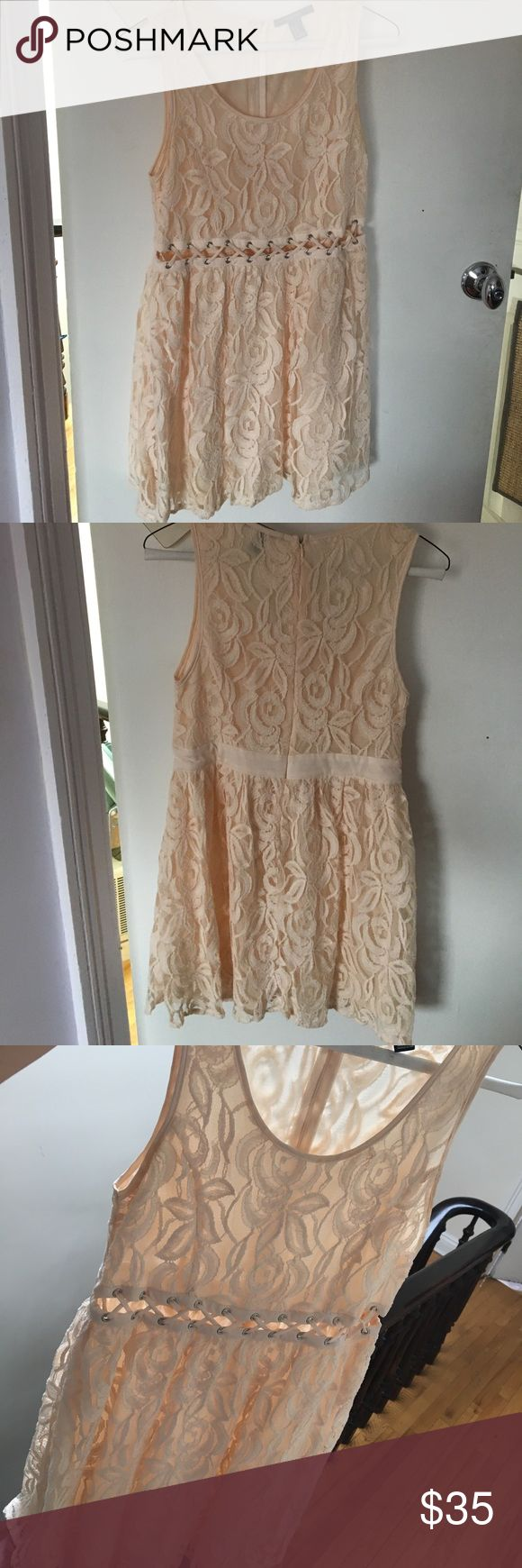 Lace cream colored dress A cute little cream colored dress! It's a great thing to wear if your going out to a fancy dinner or a party! The front has a little see through pattern which makes it so cute. I've worn this once! Forever 21 Dresses Mini