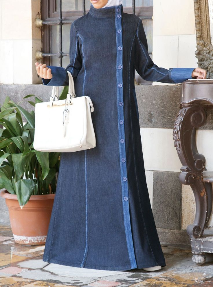 We can't get enough of this modern take on the traditional jilbab. The deeply-colored denim and bold detailing made from a lighter denim wash create an eye-catching balance and a striking contrast. Designed with a flattering cut and coloring and contemporary style elements, this piece is a welcome update to your current jilbab collection.