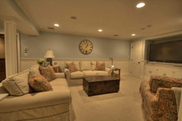 Nice, comfy spacious family room with calming colors and adaptable lighting.  Love it!