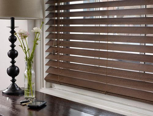 wooden blinds. I want wooden blinds. I hate the noise and look of aluminum blinds.