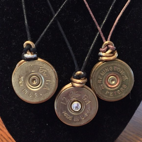 """Homemade Bullet Shell Jewelry Three homemade 12 Gauge bullet shell necklaces. Left to right: Black cord without jewel                       Black cord with jewel                       Brown cord without jewel All gold with gold clasps  Jewel can be added if requested before shipment Cross Posted Size: NOT Adjustable. 12"""" Sold separately Jewelry Necklaces"""