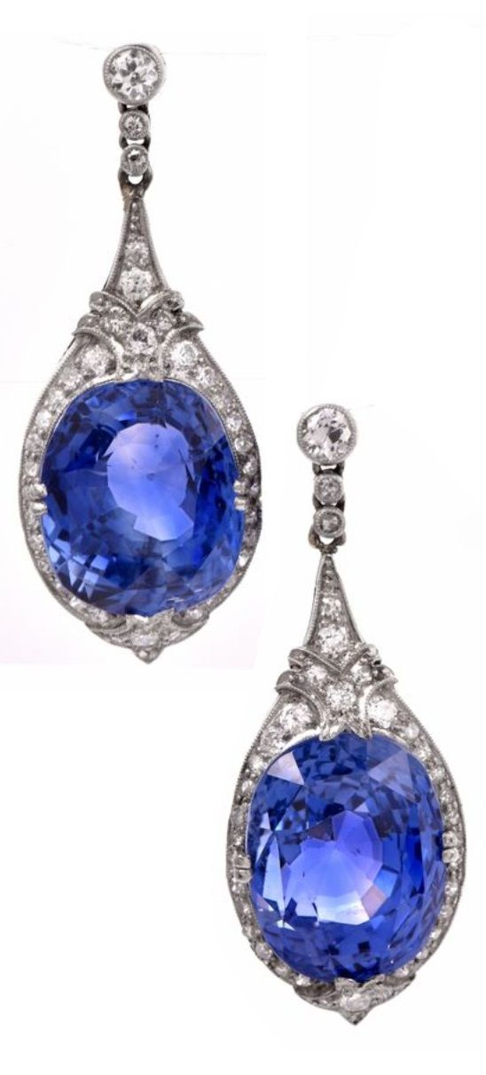 A pair of Art Deco, Ceylon sapphire and diamond earrings, early 20th century. Featuring cushion-cut natural Ceylon sapphires weighing 33.79 carats. Length 3.7cm. Accompanied by its original box from Marcus & Co. #ArtDeco #earrings