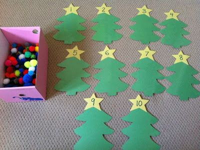 """Christmas Activities--Use pom poms as """"ornaments"""", matching the amount to the number written on the star (for math centers)"""
