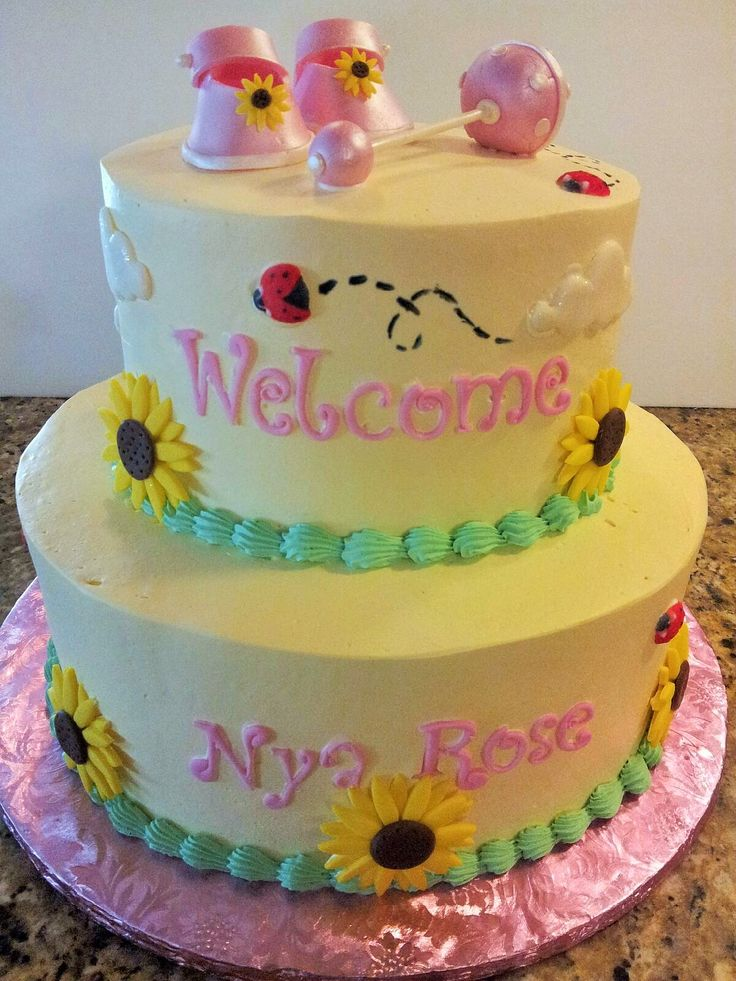 Sunflower themed baby shower cake this is an 8 and 12 for Baby footprints cake decoration