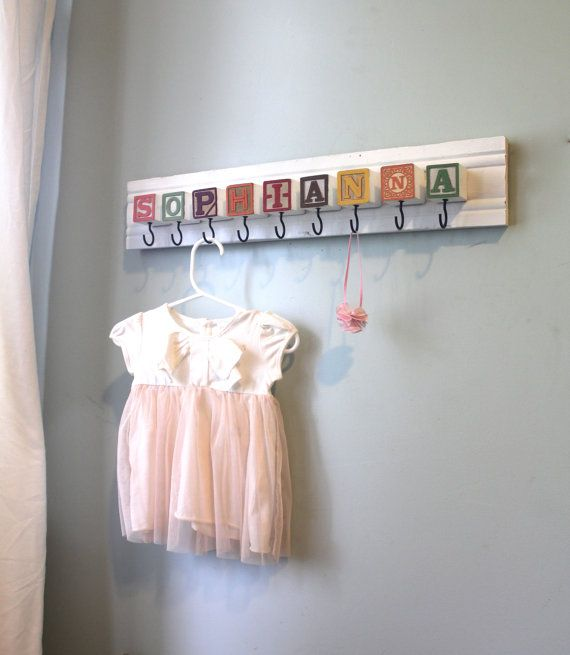 How cute is this? Love the idea! Spell out anything you want, screw hooks in the bottom of the blocks and hang it up. Lovely!