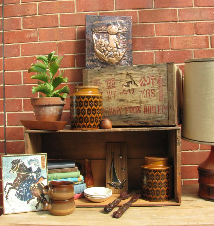 Amazing vintage styling with retro Hornsea Heirloom canister, retro lamp, copper prints, rustic crates and old books and more.  From Ruby's and Pearl's......https://www.facebook.com/744861835533003/photos/a.754268097925710.1073741833.744861835533003/754268481259005/?type=1&theater