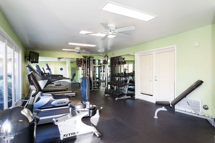 Stay fit at the gym at Uptown Fullerton! #Fullerton #Apartments #AMCLiving #LiveHappy #UptownFullerton