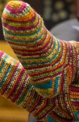 striped crochet (yes, crochet) socks, link at redheart for pdf pattern