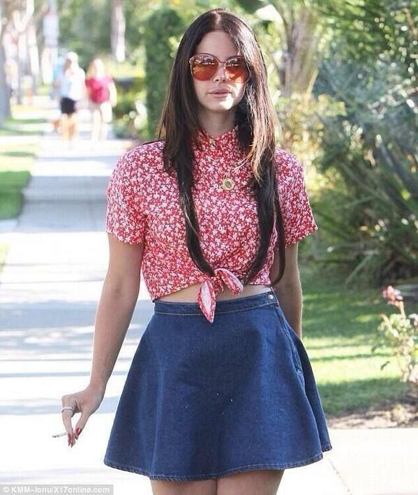 Lana Del Rey goes with full retro look as she strolls about in tiny denim skirt…