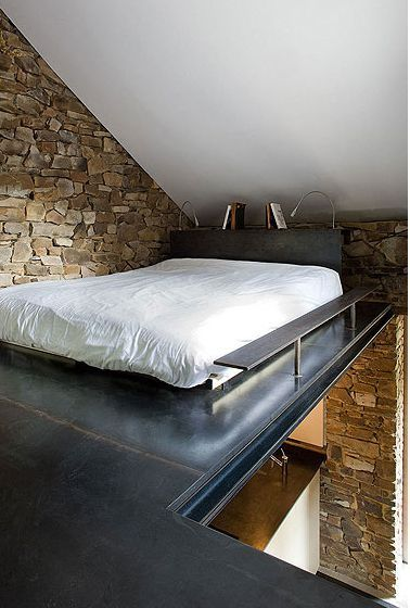 Belgian house by Bruno Erpicum.  I like the use of unusual spaces.  Works above a closet too.