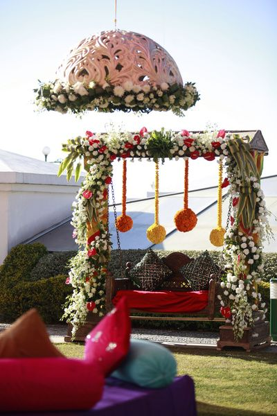 Mehendi Decor - Floral Swing with Hanging Dome and Genda Flower Balls | WedMeGood #wedmegood #indianwedding #decor #mehendidecor #mehandi #floral #genda #marigold #hangingdome #hanging