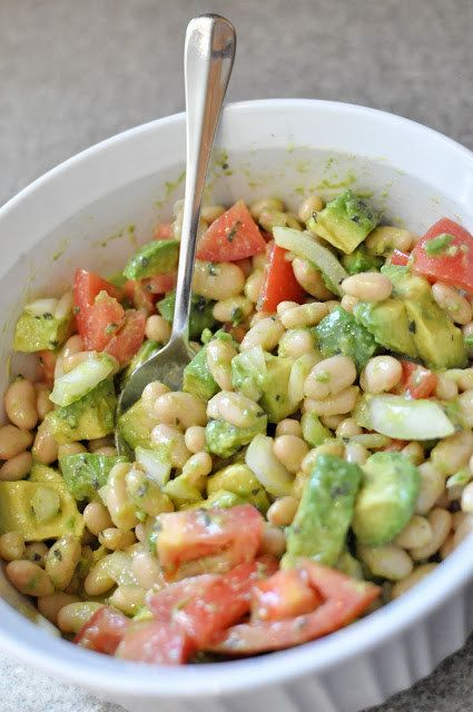 Avocado & White Bean Salad   Make this for yourself, get more than 25g of protein. Or split it with a friend, serve with two slices of whole wheat toast (4g/protein each), and get 20g. Win/win.