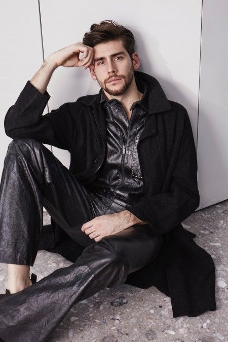 Alvaro Soler poses in a linen trench coat and leater tracksuit from Fendi.