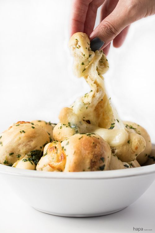 One bite of these Cheese Stuffed Garlic Knots my friends, and you'll be in garlic bread heaven. Talk about wanting to eat all 8 of them - I seriously had to put the knots down and just away.