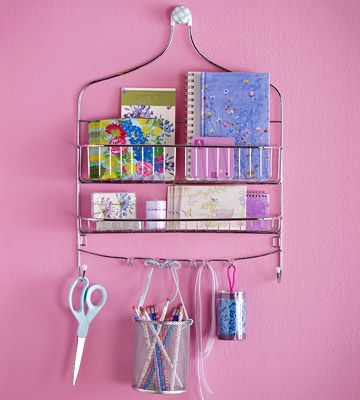Keep gift wrap and crafts supplies organized with a wire shower caddy. Hang one for wrapping supplies and a second one for crafting supplies. Use ribbons to suspend cans filled with pencils, paintbrushes, and more from the hooks.