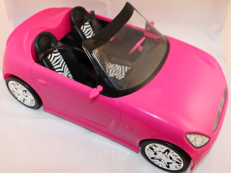 Barbie doll (doll sold separately) can hit the road in style with this super glam convertible! Designed with an open roof, this pink two-seats with Zebra print is ready for an open road adventure or a
