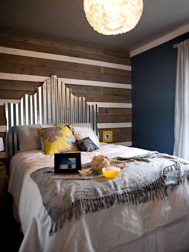 Industrial Chic headboard made out of $30 worth of corrugated tin. Coolest thing ever.