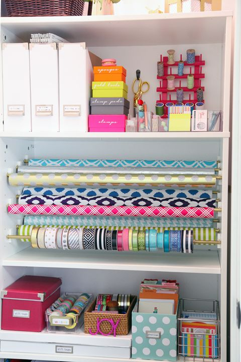 Gift Wrap Organization Station -  I love the way the rolls of wrap are hung using cup hooks & a dowel.