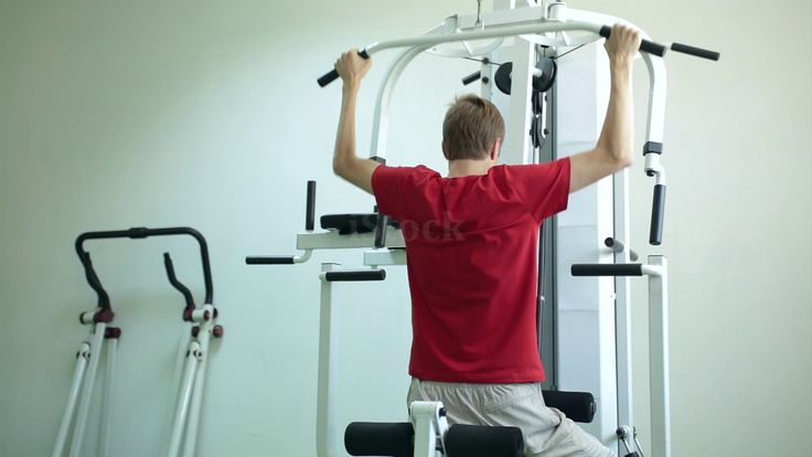 Healthy lifestyle. Young man in the gym. Stock video: http://www.istockphoto.com/gb/video/young-man-develops-muscles-on-a-simulator-gm803608710-130464211 #istock #videos #video #gym #gymtime #sport #sports #lifestyle #healthylifestyle #athlete