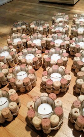 Gorgeous wine cork wrapped votives. Each votive has 10 corks with a clear glass center and white votive candle. I have 25 and am selling the lot for $100. You can easily replace with a new votive to coordinate the color with your wedding. These are being sold on Etsy for $10 each. I can ship all 25 for $25. So, for $125 you get 25x including shipping. Perfect for a winery or wine themed wedding. I can break it up for one dozen for $50 plus 15 for shipping for a total of $65.