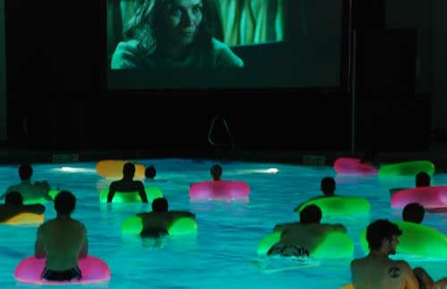Movie in the pool.  Glow lights in float tubes.