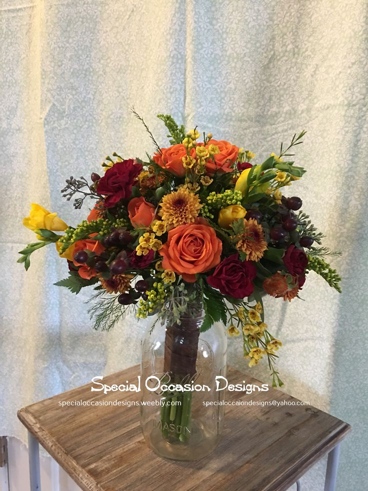 Fall mix junior bridesmaid bouquet. Roses, freesia, mini carnations, button mums, spray roses, wax flower, solidago and hypericum berries