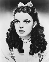 Judy Garland posing as Dorothy Gale, her eyes say it all.