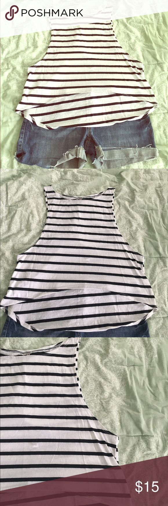 Black and white stripe hi-lo tank Adorable black and white stripe hi-lo tank top. Size medium. In excellent condition. Arm holes on side are cut large. Looks super cute over a swim top or with and bandeau bra. Tops Tank Tops