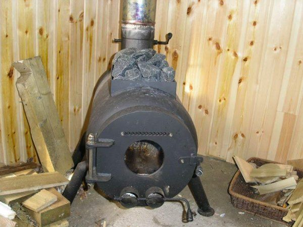 This homemade sauna stove has a sauna stone holder welded on top.