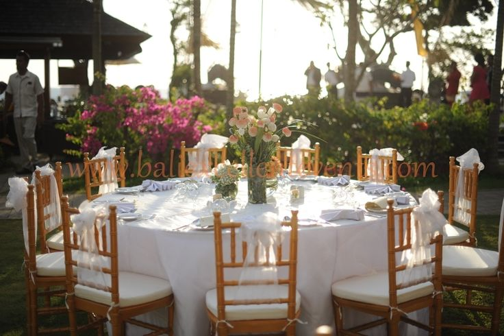 Gold Tiffany Chairs with coral centerpiece, elegant and warm color choice