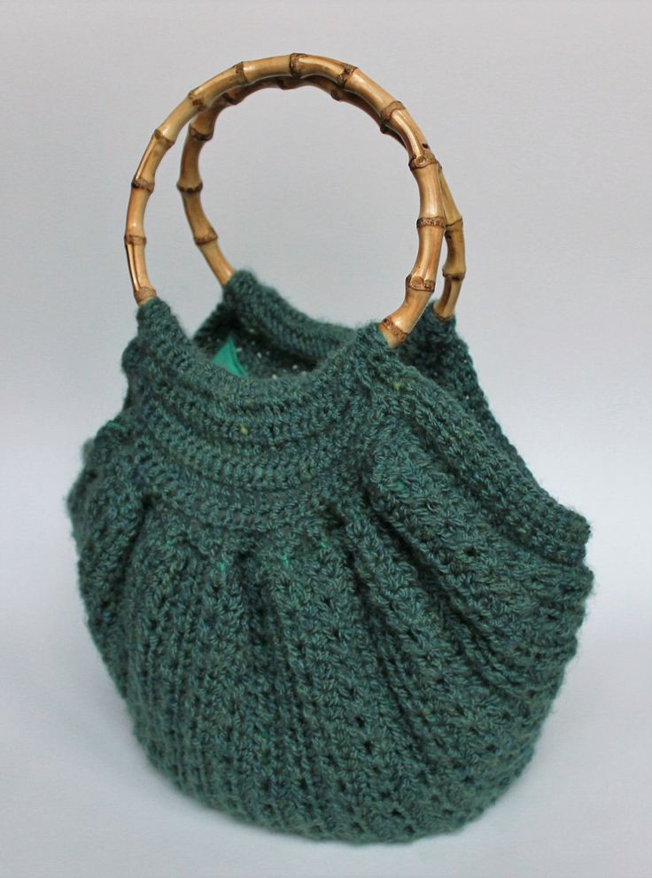 Green crochet bag with bamboo handles