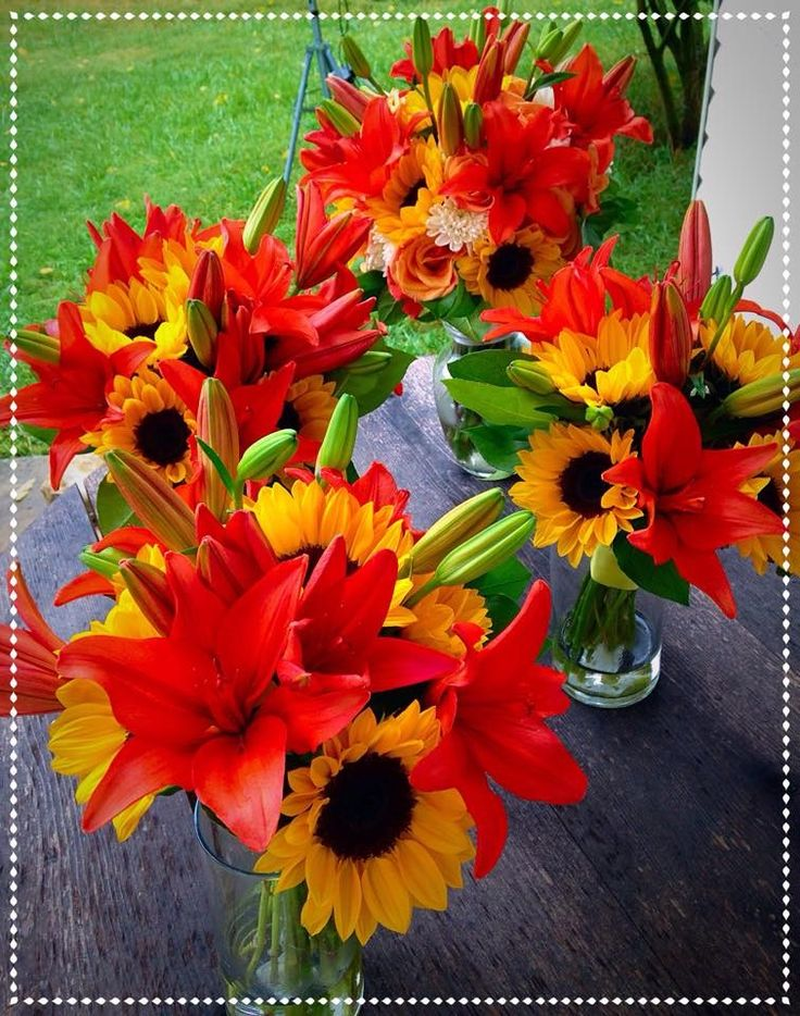 bridal bouquets: orange lilies, sunflowers  Weddings North Manchester, IN 46962 | Rhinestones and Roses , Local Florist