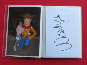 cute idea - make a disney autograph book out of a mini photo album and then add the pictures of the kids with the characters when you print the pictures!