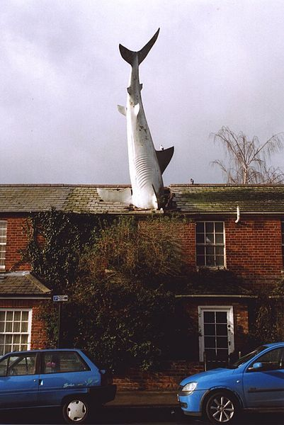 The Headington Shark is a sculpture situated at 2 New High Street, Headington, Oxford, England, depicting a shark embedded head-first in the roof of the house.