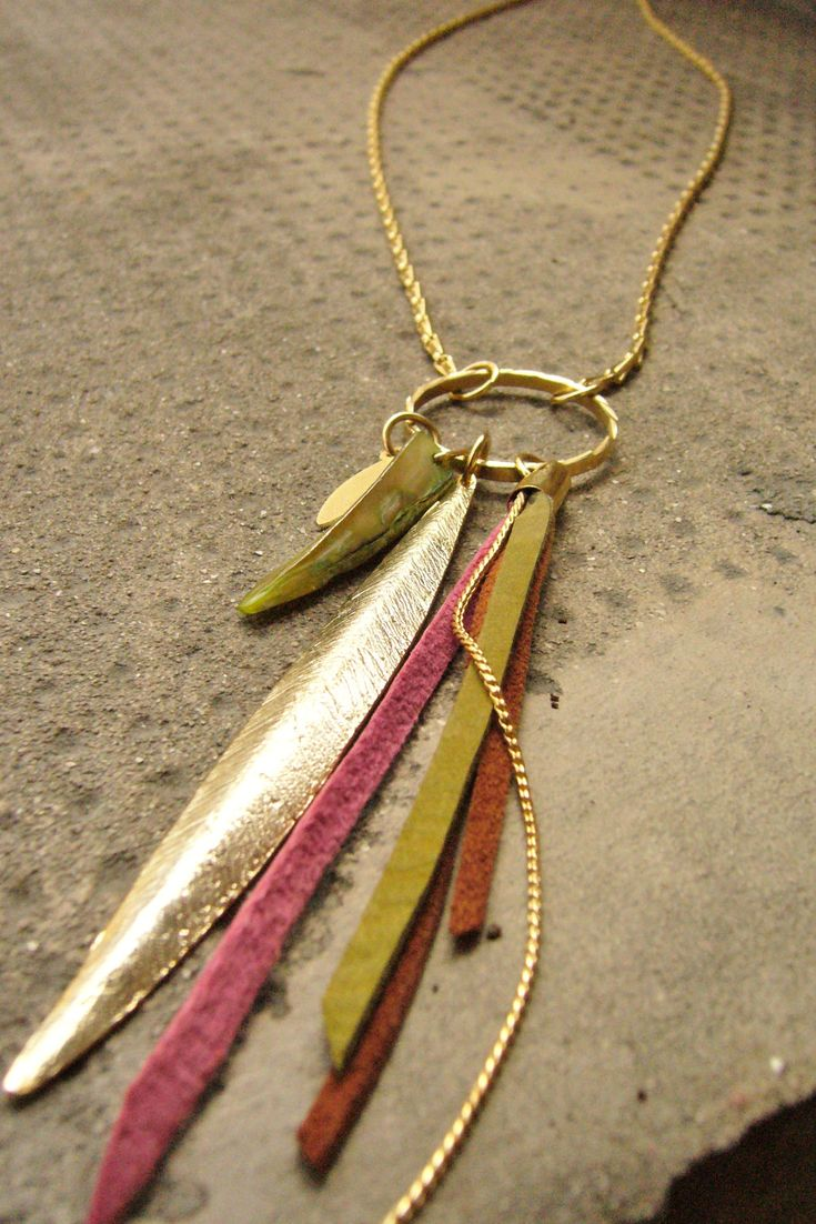Long Necklace- Leather Necklace Bird of Paradise Leather Fringes and Gold Feather. $89.00, via Etsy.