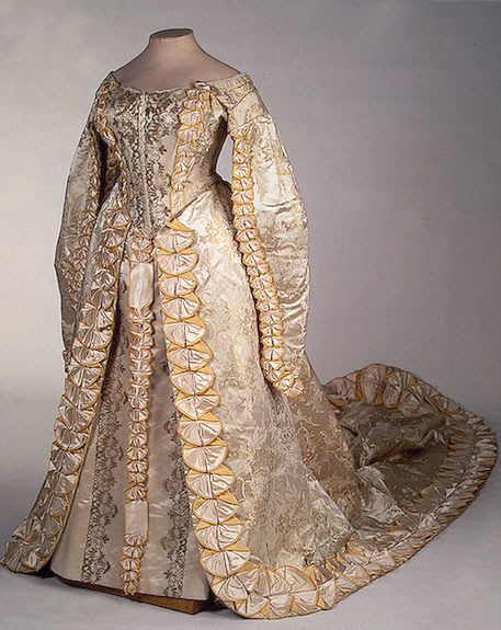 "Russian court dress, ca 1900    I find it fascinating that Russian court dress managed to retain elements of 16th century fashion into the 20th century.  The unusual split sleeves once worn by Queen Elizabeth I even came to be known as ""Russian sleeves""."